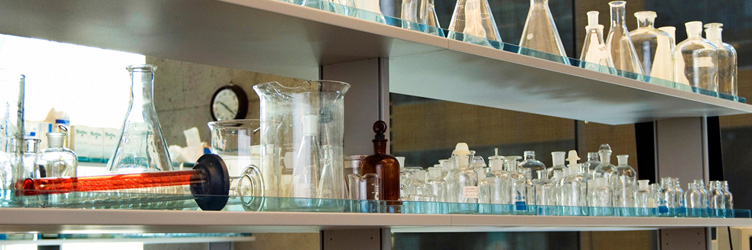 Lab bench with glass beakers and flasks.