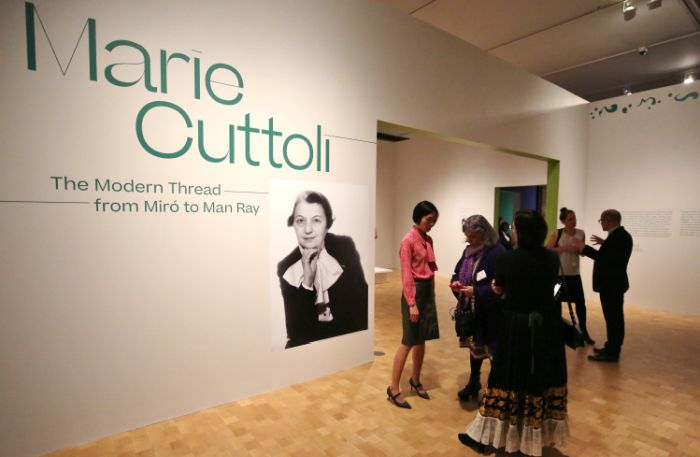 Exhibition curator Cindy Kang welcomes guests to Marie Cuttoli: The Modern Thread from Miró to Man Ray at the Barnes