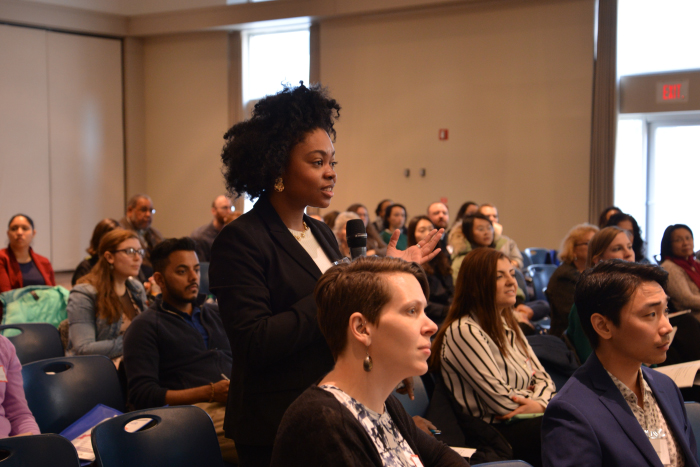 An attendee asks a question at the 2019 Sex and Gender Research Forum