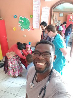 Drexel medical student Richard Smith in Quetzaltenango, Guatemala: Nutrition Clinic Selfie (local mother and child assisted by resident and 2 medical students)