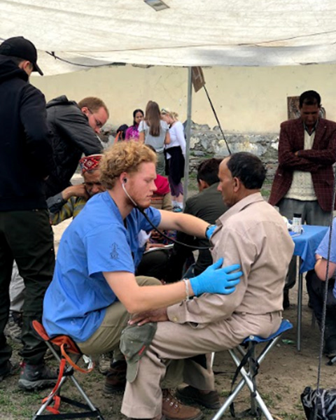 Drexel medical student Ridgley Schultz in the clinic during his Global Health Experience