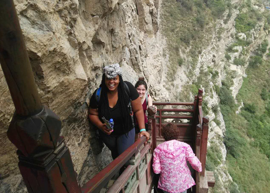 Drexel MD student Chalon Forbes climbing the Hanging Monastery in Datong.