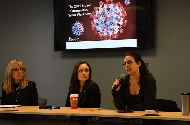 Shara Epstein, MD, answers a question at the College of Nursing and Health Professions event as Deborah Clegg, PhD, pictured left, and Merritt Brockman, DHA, seated in the center, look on. Photo courtesy Craig Schlanser.
