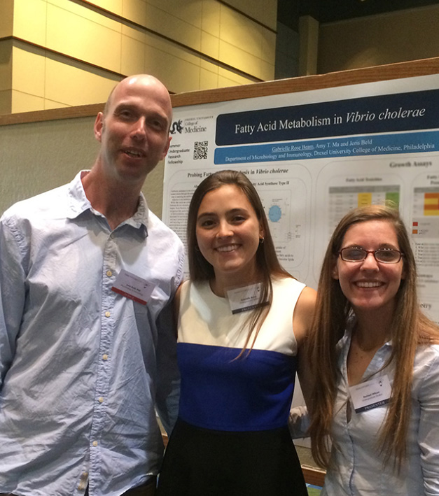 Joris Beld, PhD, Assistant Professor at Drexel University College of Medicine (left), with his lab's Summer Undergraduate Research Fellow, Gabrielle Rose Beam (middle), and undergraduate volunteer, Rachael Wilson (right), at Discovery Day 2016.
