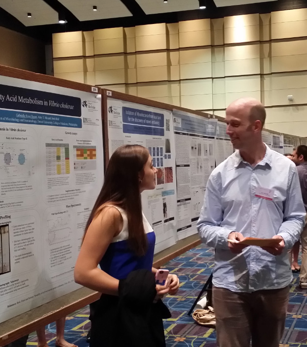 Summer Undergraduate Research Fellow, Gabrielle Rose Beam, presents her poster to Joris Beld, PhD, an assistant professor at Drexel University College of Medicine.