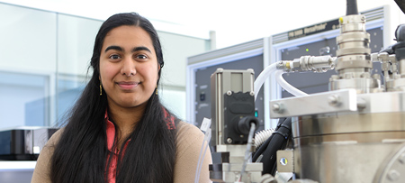 Drexel graduate student working in a biomedical research lab, standing next to laboratory equipment.