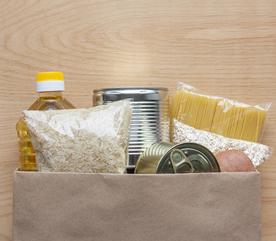 Grocery items in paper bag.