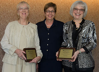 Page Morahan and Rosalyn Richman received honorary ELAM degrees from Diane Magrane at the May 1 graduation ceremony.