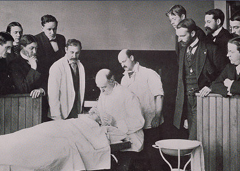 Hahnemann University students observing a medical class, 1899.