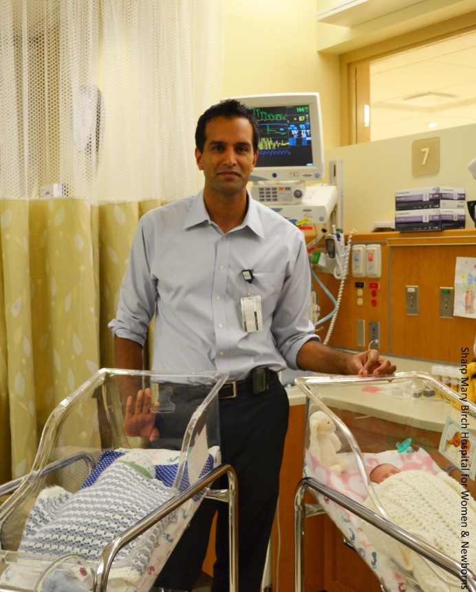 Anup Katheria, MD, with two newborns.