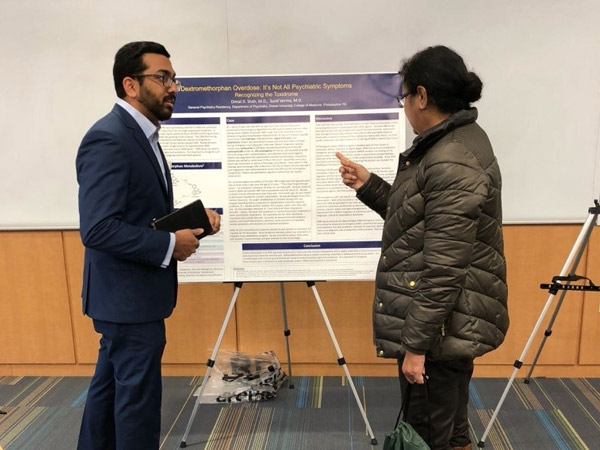 Dr. Shah presenting his research poster at the 2018 Addiction Symposium