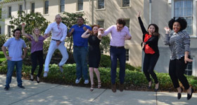 Child/adolescent psychiatry fellows jumping outside Friends Hospital
