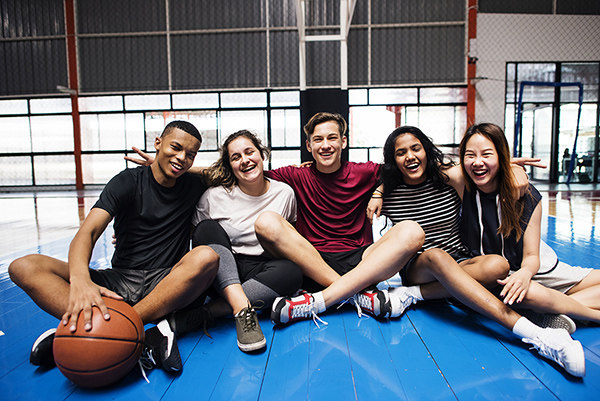 A group of students gathered in a recreational facility.