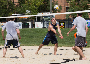 Students playing volleyball at the 2014 Dean's Cup event at Drexel University College of Medicine.