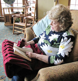 "Megan Peaslee's ""Acute Reader"" book stand helps aging people read without pain"