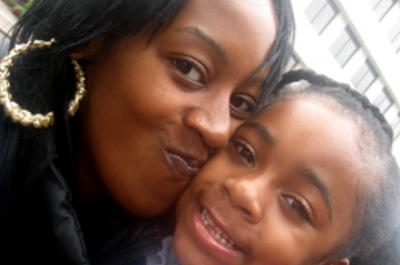 Juell F., a Boston member of Witnesses to Hunger, with her daughter