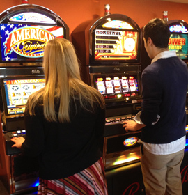 Students in the casino training lab during a class on casino management