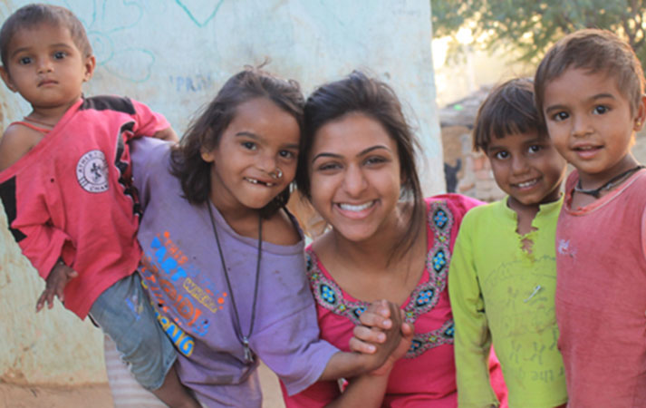 Drexel student Rina Patel with children in India