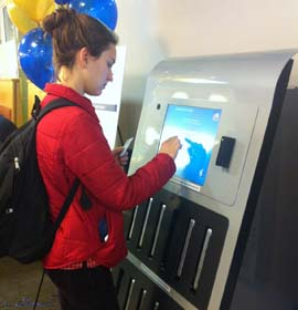 A Drexel student signs out a MacBook for use