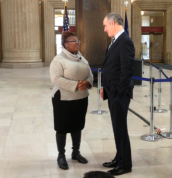 Tianna Gaines-Turner, a participant in Drexel's Witnesses to Hunger program, speaks with Senator Bob Casey, who invited her to attend the State of the Union address.