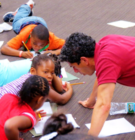 Theater Program Director Nick Anselmo works with kids in the Mantua in Action summer program