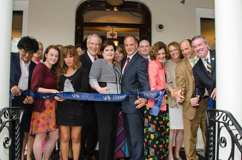 Dana and David Dornsife together with Drexel representatives and the Lindy family cut the ribbon.