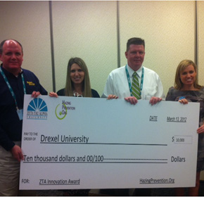 Drexel representatives inlcuding Drexel Dean of Student David A. Ruth accept the $10,000 grant from the Zeta Tau Alpha Foundation.