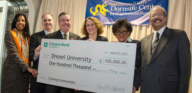 Drexel and Citizens Bank representatives with government officials and a $100,000 check