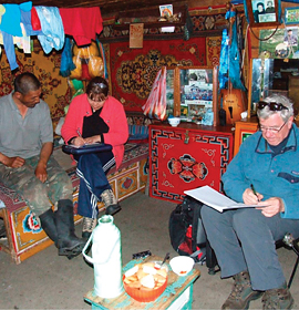 Dr. Clyde Goulden (foreground) interviews a Mongolian herder in his home. Credit: Lkhagva Ariuntsetseg