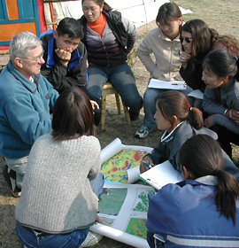 Dr. Clyde Goulden (far left) discusses climate change with Mongolian students. Credit: Dr. Bazartseren Boldgiv