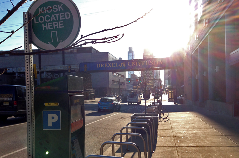 A parking kiosk in University City, Philadelphia, is adjacent to bicycle racks, a bus stop and a subway station.