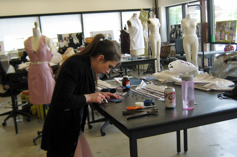 Rebekah Quasny puts the finishing touches on her collection to be shown at the annual senior fashion show.