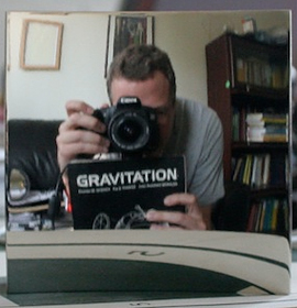 R. Andrew Hicks takes a photo of himself in the non-reversing mirror he invented.