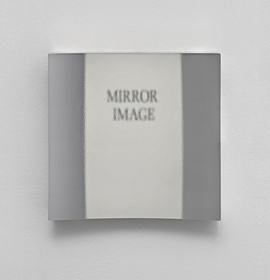 "The words ""mirror image"" are reflected, but not reversed, in this photo of the Hicks non-reversing mirror taken at Robin Cameron's art show. Photo courtesy Room East in New York."