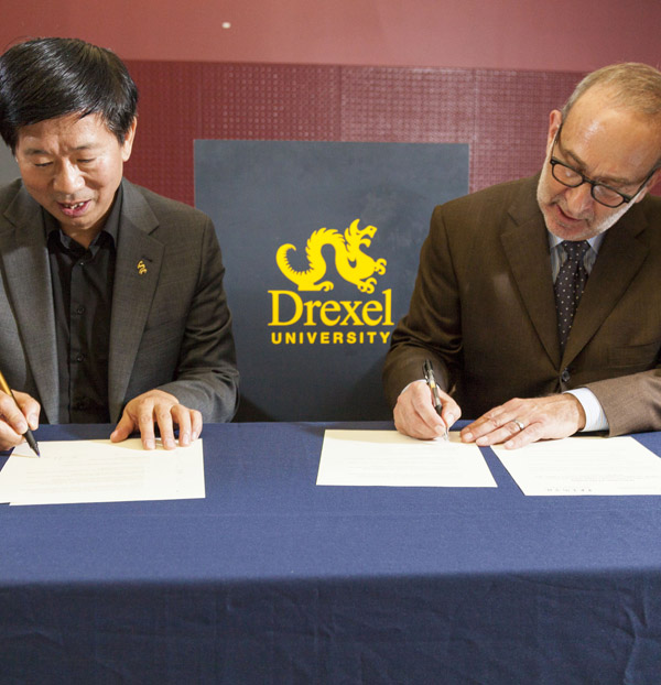 Wang Min, dean of CAFA's School of Design, and Allen Sabinson, dean of the Westphal College, signed a memorandum of understanding (MOU) at the opening reception on Oct. 4. Photo credit: Shan Cerrone.