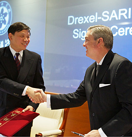 A handshake marks the partnership between Drexel and the Shanghai Advanced Research Institute.
