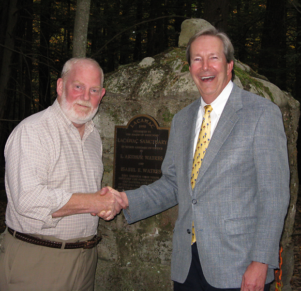 Stephen C. Lawrence (left), chairman of the Lacawac Sanctuary Foundation, and George W. Gephart, Jr., president and CEO of the Academy of Natural Sciences of Drexel University, shake hands over an agreement to form an environmental research and educational consortium at Lacawac in the Pocono Mountains. The consortium also includes Drexel University.
