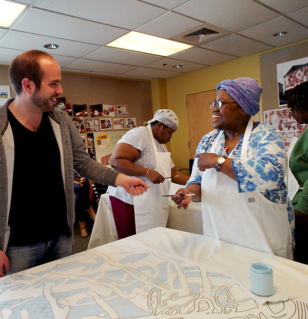 Artist Ben Volta interacts with participants in the Porch Light program at Drexel's 11th Street health center. Photo by Lynn Johnson