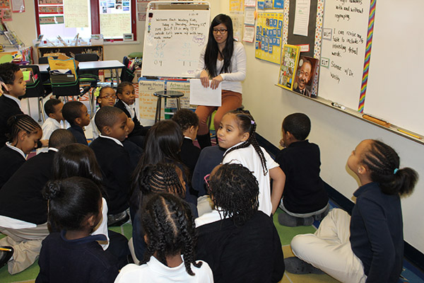 Selena Lin with elementary students