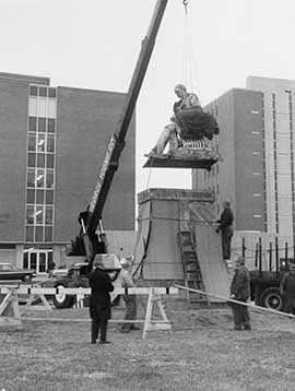 The Drexel statue in mid-relocation.