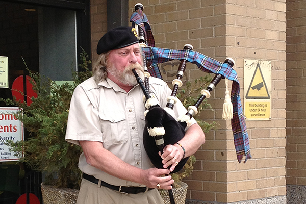 Curt Anderson playing bagpipes