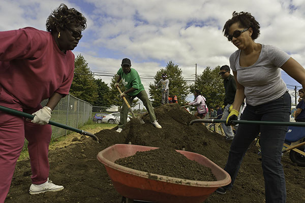 Community members help build the garden.