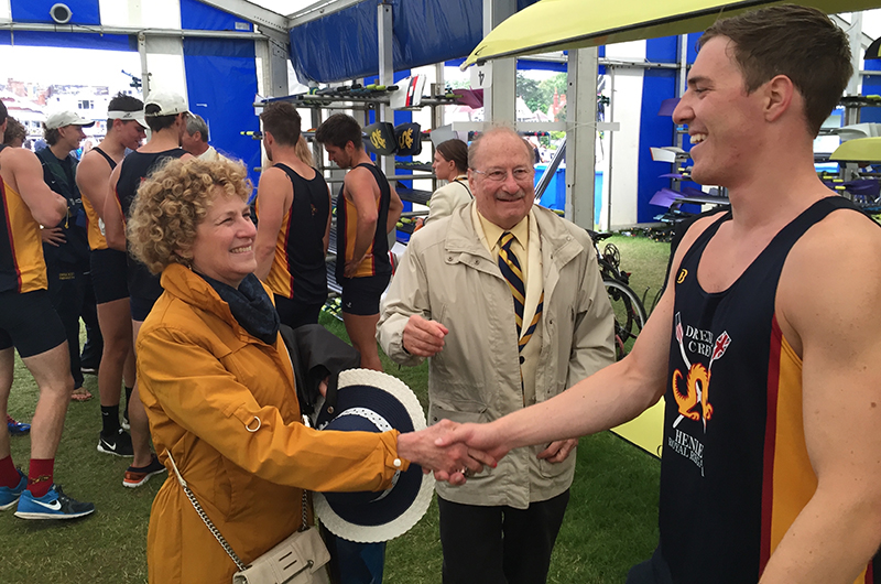All smiles after beating Dublin. Alumna Sandy Sheller and her husband and Drexel Board of Trustee member Steve, congratulate senior Dan Palombo after the race.