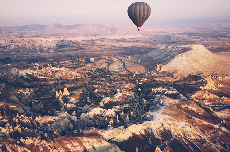 "1st Place - Cory Quigley, Turkey: ""Drifting in an air balloon above alienesque Cappadocia"""