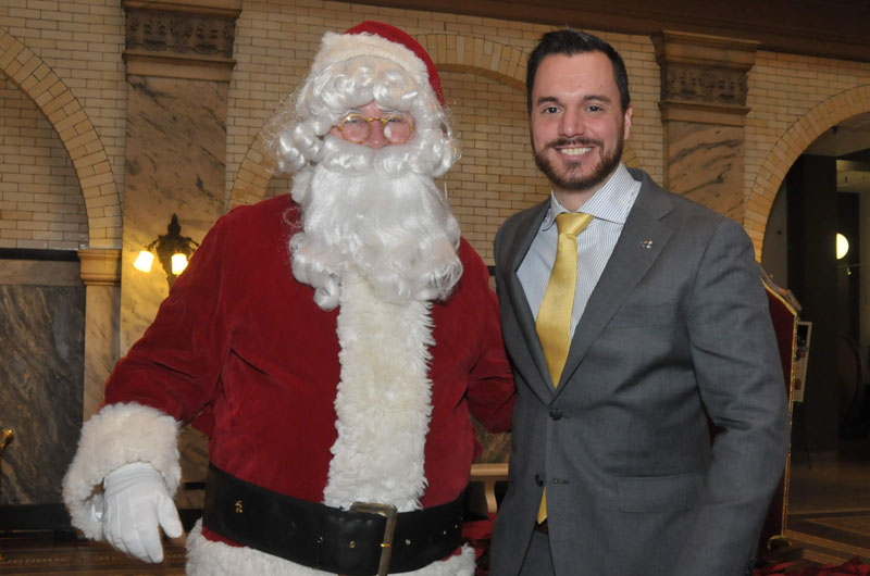 Dimitrios Boufidis, who helped spearhead the toy drive, poses with Santa.