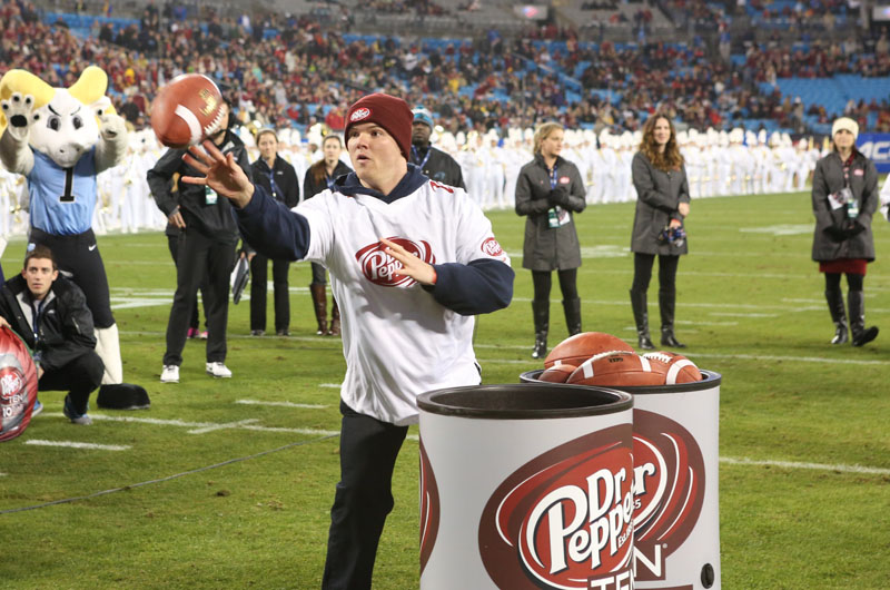 Grad student Michael Dodds throws for the win in the Dr Pepper Tuition Giveaway contest. Photo credit: Dr Pepper.