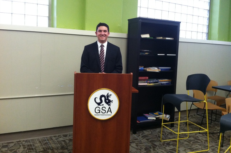 Nick Thompson, president of the Graduate Student Association, stands in the graduate student lounge he hopes to renovate.