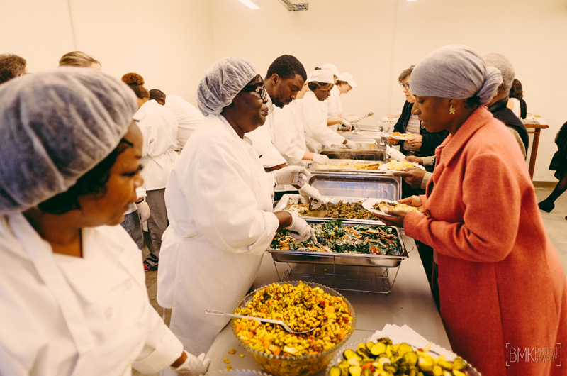 The students had the opportunity to prepare, cook and serve recipes by celebrity Chef Carla Hall at the Dornsife Center's community dinner on Oct. 7. Photo credit Brian Michael Kinney.