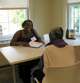 Law students meet with community members during client in-take sessions.
