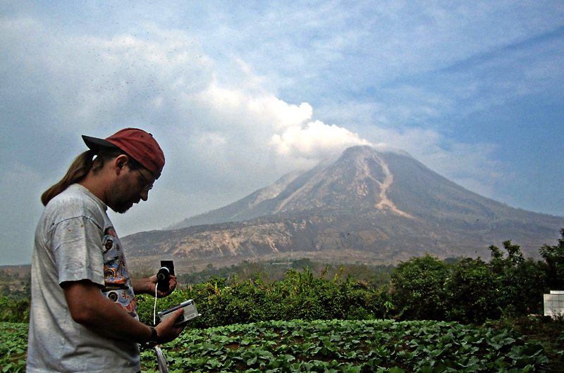 Loÿc Vanderkluysen, PhD, monitors the active volcano Sinabung in Indonesia.